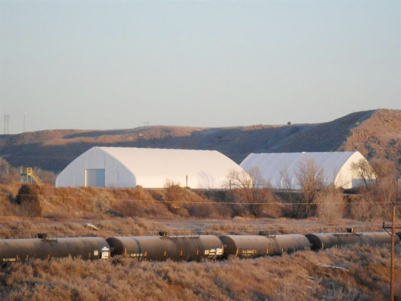 73'W by 160'L (foreground) and 73'W by 100'L - Glendive, Mont. - The oil business has been booming in the northern plains! For adequate equipment storage, and in this case, sand sacs for oil drilling operations, look to ClearSpan for not one, but two fabric structures!