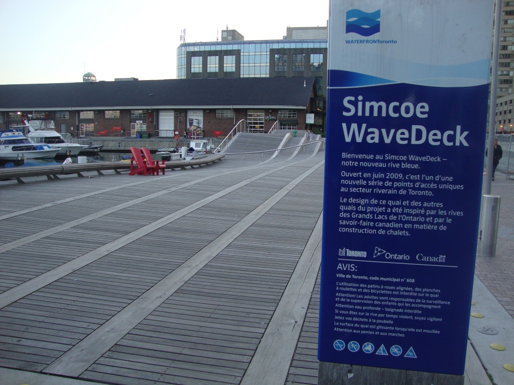 "Here's something you don't see every day. Check out this fantastic ""wave deck"" at the marina! Boats don't travel underneath, but it certainly resembles the wakes from vessels that are left behind – really cool stuff!"
