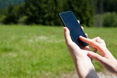 smart-phone-use-touching-field-55306979